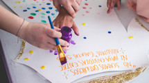 kids painting signs