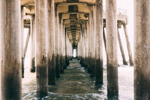 Underneath a pier at the beach