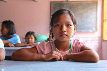 Young girl in classroom in Myanmar