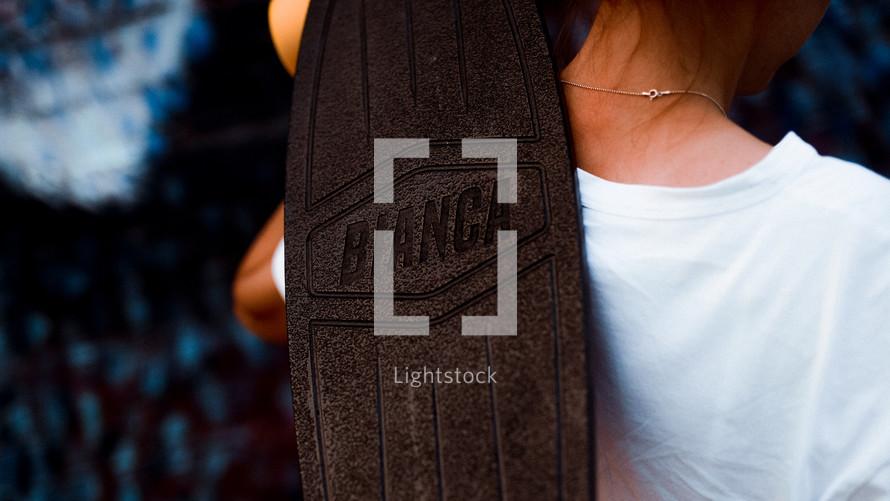 woman holding a skateboard