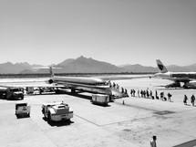 Boarding an airplane on the tarmac