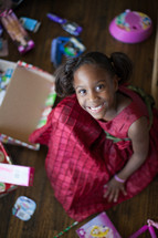 a girl child opening Christmas gifts