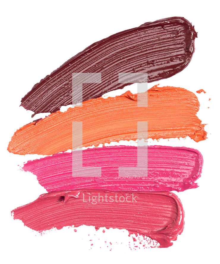 Four Shades of Lipstick and Lip Gloss Swatches Isolated on a White Background