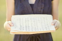 woman holding sheet music