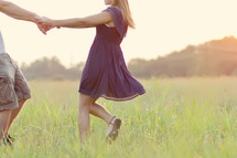 Couple dancing in a meadow.