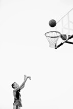 boy child shooting a basket playing basketball