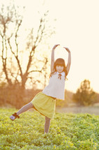 girl child twirling outdoors