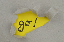 ripped open paper with the word GO!
