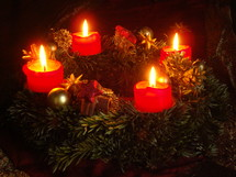 Advent candle wreath with four burning candles,   wreath, candle, Advent, lit, flame, fire, red, green, gold, burning, christmas, ritual, grave, solemnly, four