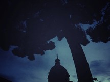 silhouette of the top of a church steeple