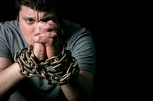 a man with arms in chains