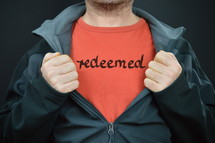 a man with the word redeemed on his t-shirt