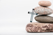 cross and stacked stones