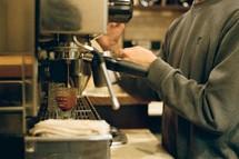 barista brewing espresso