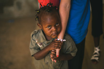 innocent child holding the hand of a missionary