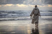 Jesus walking on a beach