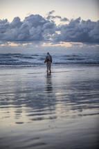 Jesus walking into the ocean