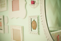 frames and mirrors hanging on a wall