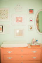 frames, mirror, changing table, nursery