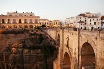 villas along a cliff and bridge across a ravine