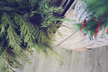Christmas greens and wood floor