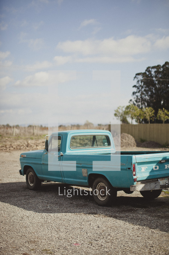 Old truck parked on gravel