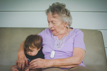 grandmother sitting with her infant grandson
