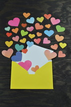 hearts pouring out of an envelope