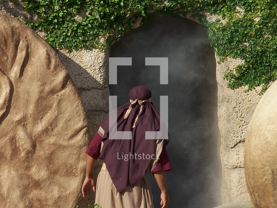One of Jesus' Disciples looks in amazement into the empty tomb of Jesus with the stone rolled away, the seal of Rome broken and Jesus body no where to be found,