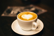 heart shape in a mug of cappuccino