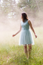 girl in a dress standing in a field