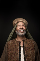 smiling face of a wiseman