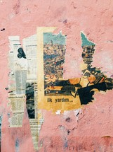 Torn old newspaper against a wall