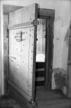 an old open wood door