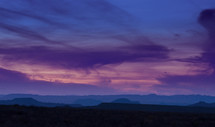 Silhouette of a mountain range at dusk.