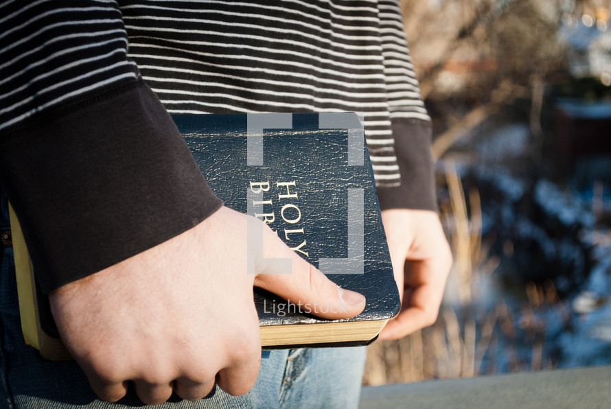 young man holding a Bible