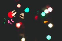 bokeh colored lights in darkness