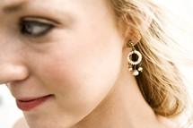 profile of a woman wearing earrings