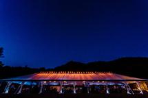 light of a wedding tent blue hour, blue sky, event, party mountain