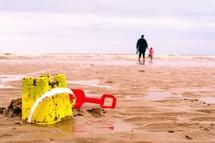 sand buckets on a beach