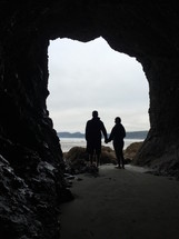 couple standing in a cave