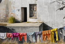 clothes on the line in front of an old building