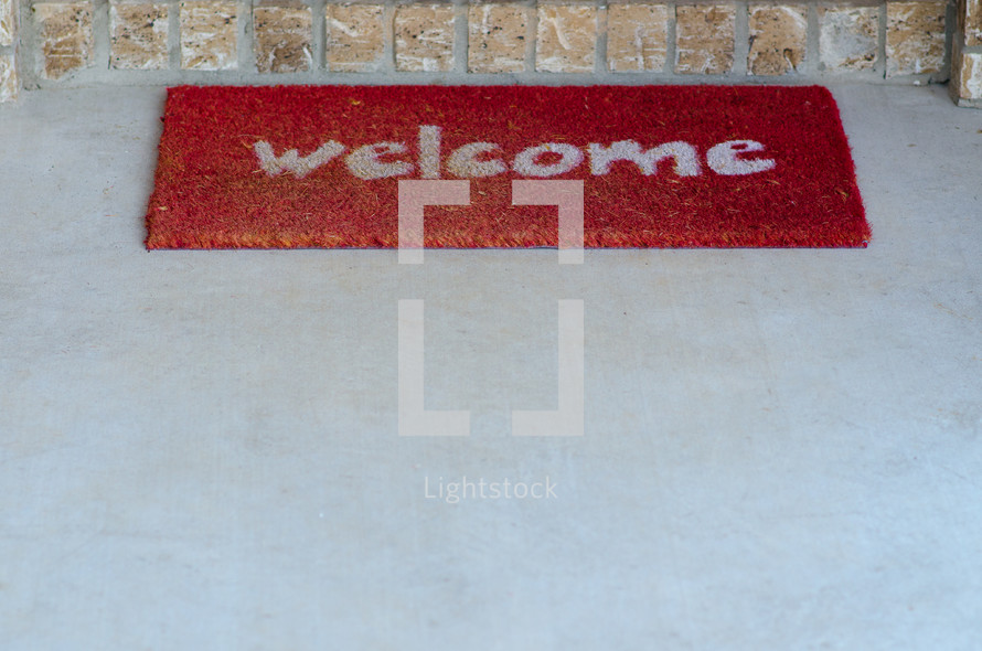 Welcome mat at the front door.