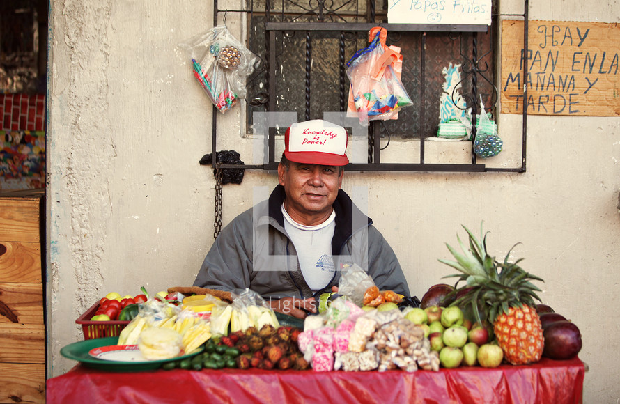 Man selling fruit on table