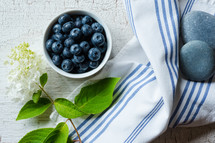 blueberries, flowers, on a hand towel