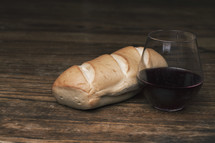 bread loaf and cup of wine