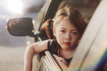 Unhappy sadness, Asian girl in car going to a foster home