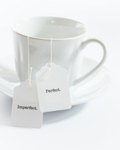 tea cup with the words perfect and imperfect on the tea bag