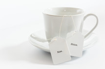 tea cup with the words rise and shine on the tea bag