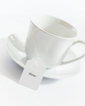 tea cup with the word shine on the tea bag